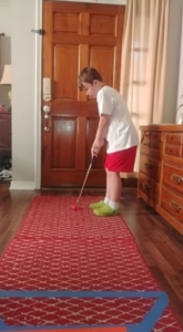 First Tee golfer with homemade golf course
